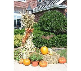 Fall Decorating with hay bales, pumpkins, mums, and corn