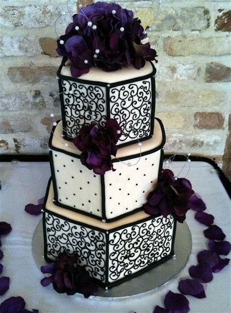 Three tier hexagonal wedding cake in ivory and black with