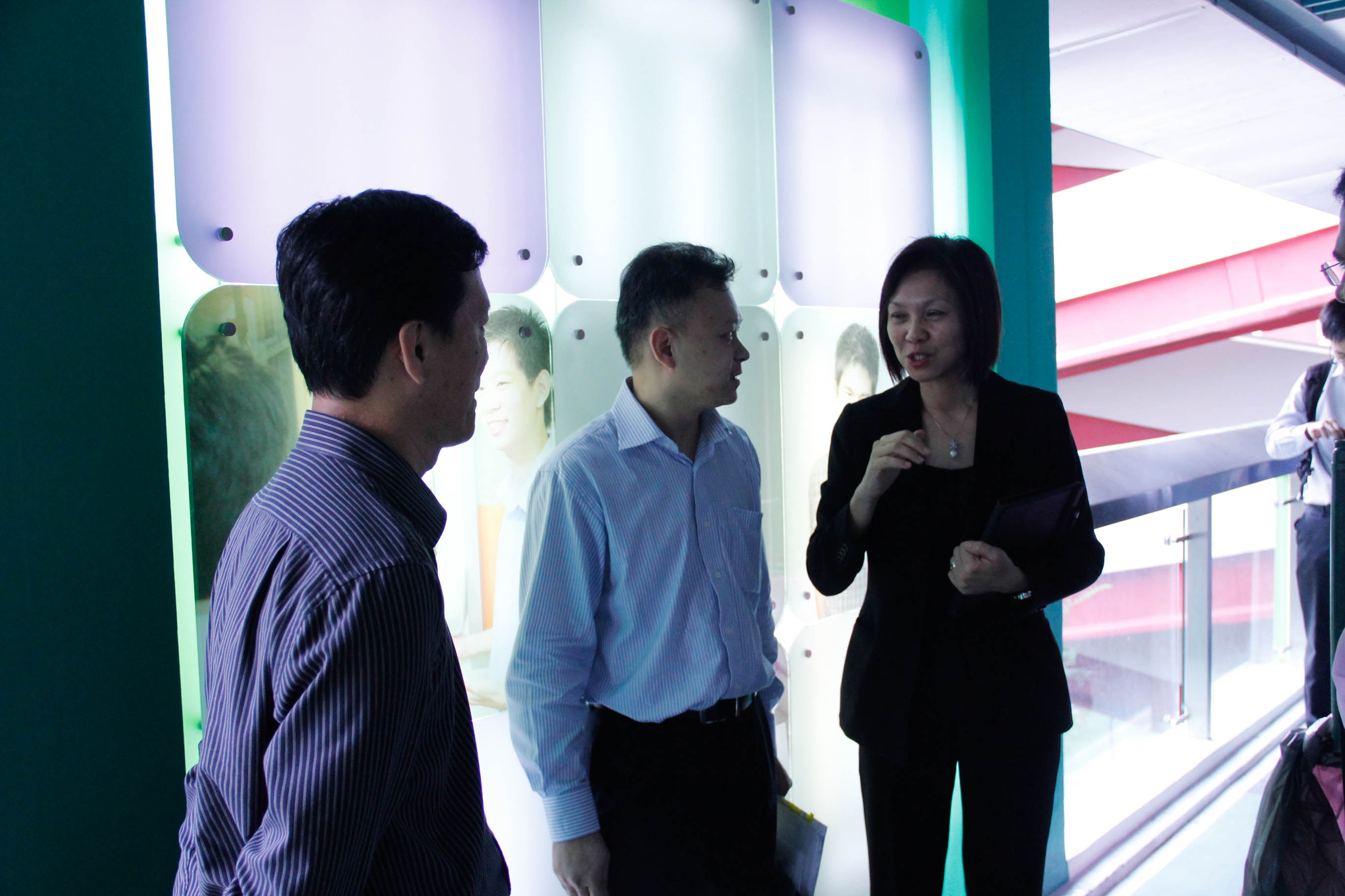 Mr Liew, Mr Ho and Ms Phua having conversation after the event proper