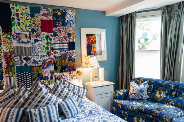 Bedroom - A mosaic of fabric replaces a traditional headboard