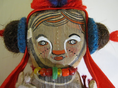 the red handed child in ceremonial head-dress - detail