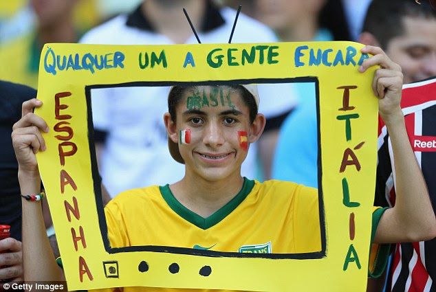 On the box: A spectator enjoys the party atmosphere in Fortaleza