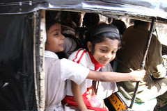 school kids in school rickshas are packed like sardines in a tin by firoze shakir photographerno1