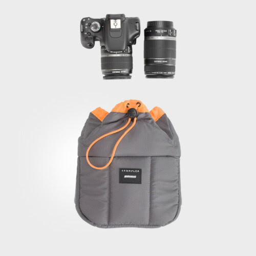 """While I was browsing the crumplerbags site the other day looking for a link to the bag that I currently have, I saw this as one of their new releases. This is a portable padded camera protector. It can go in any bag so you can store your camera safely. This is a genius idea! The Haven comes in three sizes depending on how much you want/need to carry. The Medium is supposed to carry a camera and two lenses, with one attached. There are also pockets on the back that hold cables, memory cards, and lens caps. It is made of a water-resistant material and the padded sides fold down on top to provide 360 degrees of protection. Dimensions: S: 7.8"""" x 8.6"""" x 3.9"""" M: 8.6"""" x 8.6"""" x 4.7"""" L: 10.2"""" x 9.2"""" x 5.5"""" $50.00 Since my crumpler bag has lasted for a while I'm sure this will as well."""