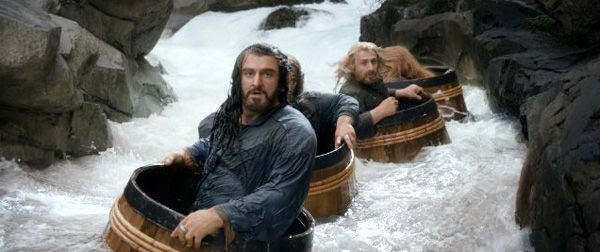 Thorin Oakenshield (Richard Armitage) and his fellow dwarves take a ride down a river as Orcs  pursue them in THE HOBBIT: THE DESOLATION OF SMAUG.