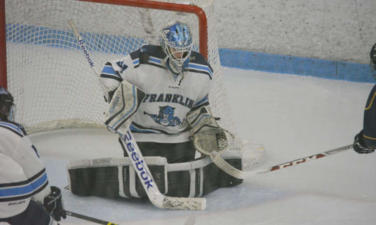 Franklin goalie Nick Jasinski (31) makes one of his 19 saves against Malden Catholic on Wednesday. (Josh Perry/HockomockSports.com)