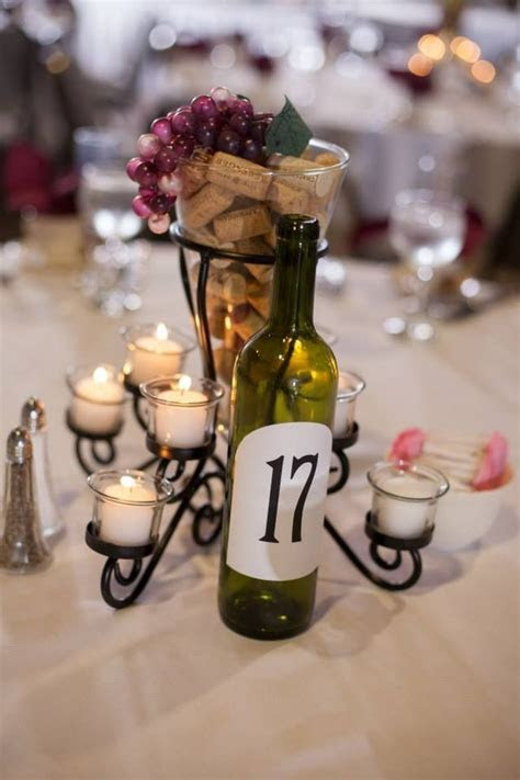 Centerpieces for wine theme wedding   similar to these