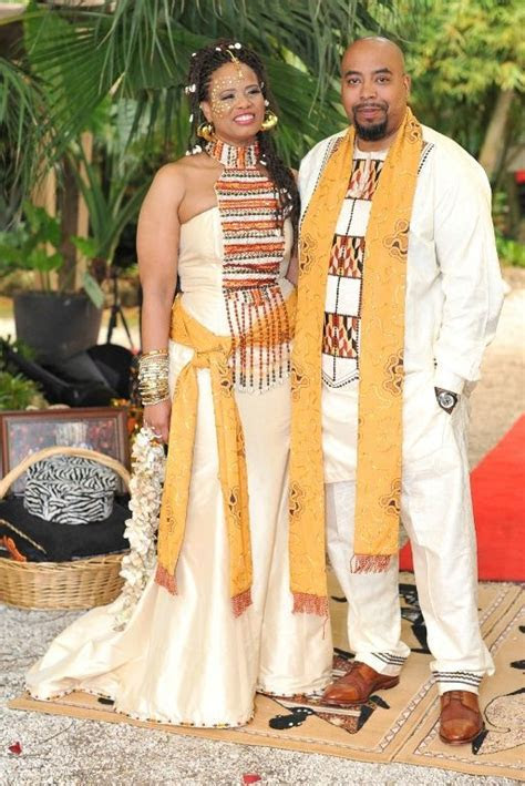 Grooms attire by TeKay Designs. Bridal gown by Therez