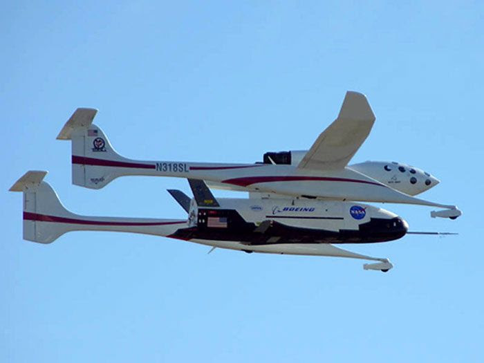 Attached to a Scaled Composites' White Knight aircraft, the OTV undergoes a flight test in this NASA file photo.