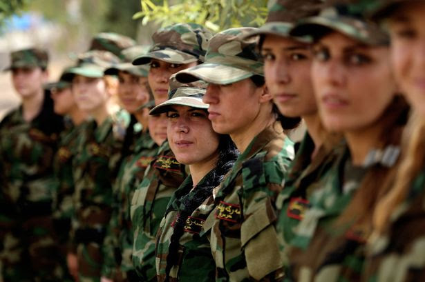 Iraqi Yezidi women are seen during a military training