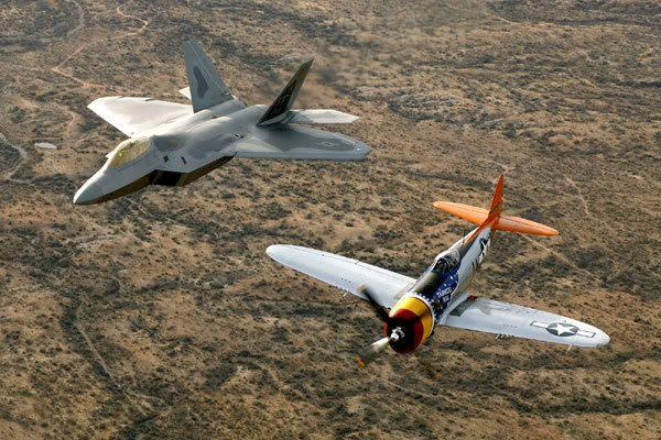 An F-22 Raptor and a World War II-era fighter.
