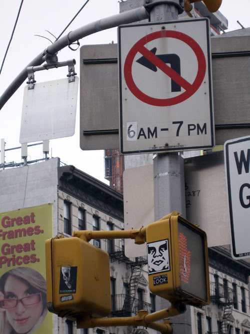 street signage and decals on Delancey Street, Manhattan, NYC