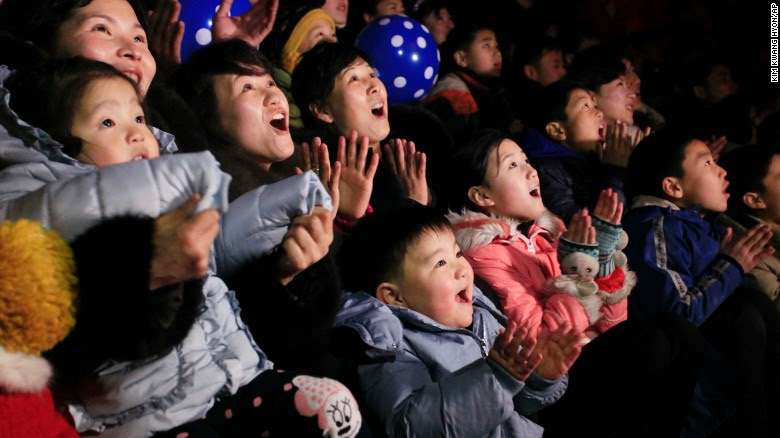 North Koreans watch a New Year's fireworks display at the Kim Il Sung Square in Pyongyang, North Korea, on Sunday, Jan. 1, 2017.