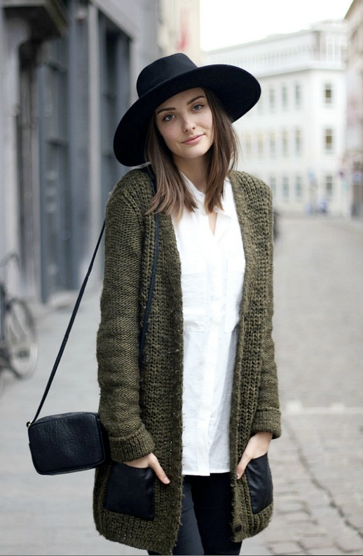 LE FASHION BLOG STREET STYLE BLACK WHITE ARMY GREEN POLIENNE BLOGGER PAULIEN GREEN CARDIGAN SWEATER WITH BLACK LEATHER POCKETS BUTTON DOWN SHIRT WITH PICKETS OVERSIZEDBLACK HAT SMALL CROSSBODY BAG BLACK JEANS FALL WINTER INSPIRATION 1 photo LEFASHIONBLOGSTREETSTYLEBLACKWHITEARMYGREENPOLIENNELEATHERPOCKETS1.png