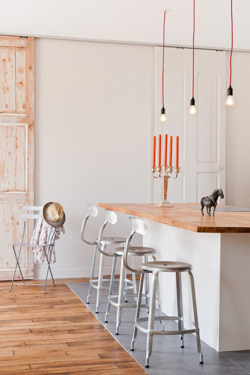 monosquare:  Simple dinning space with subtle rustic wood elements. Photo: Marion Alberge URL from:  http://aucoindumonde.com http://www.marionalberge.com