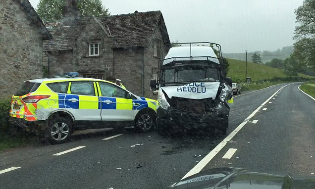 Two police cars wrecked in head-on smash on a quiet Welsh country road