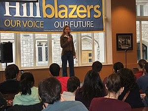 Chelsea Clinton speaking to a group of student...
