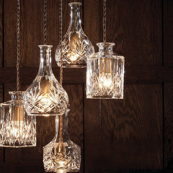 Cut glass wine decanters get a second life as stunning ceiling lamps.
