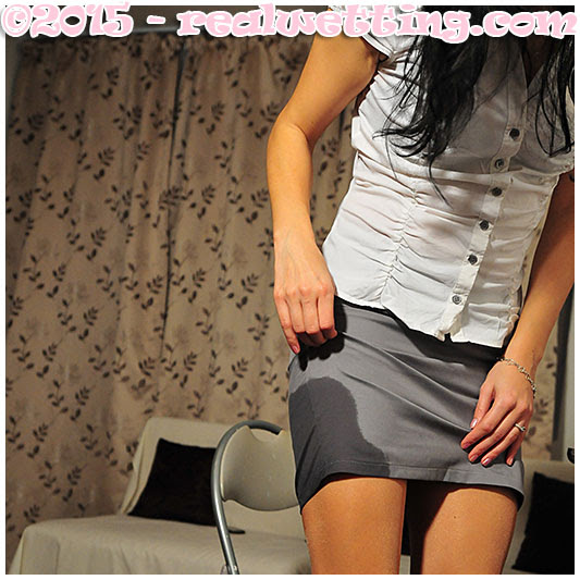 Hot girl Antonia peeing her pants at the office