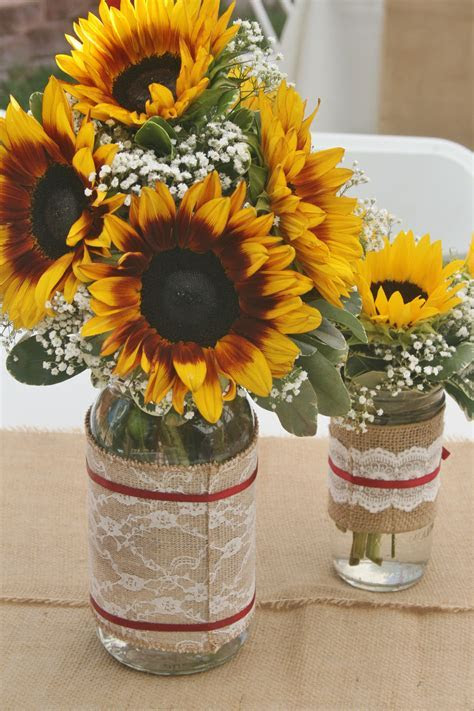 Sunflowers and baby's breath in a mason Jar as rustic