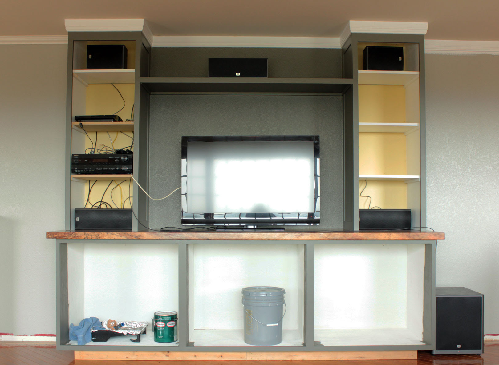 entertainment center painted gray with gray back