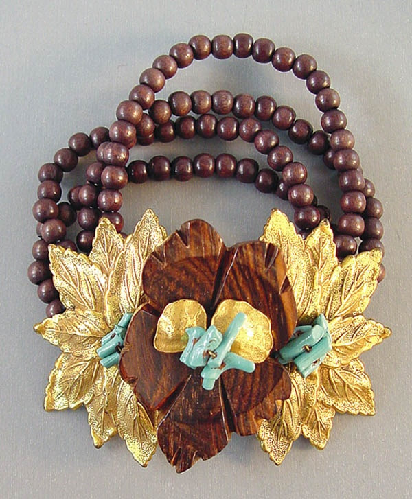 Hess carved wood flower and aqua painted coral bracelet with gold tone leaves. A Frank Hess design for Miriam Haskell, unsigned.