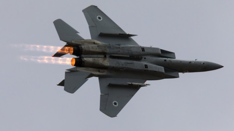 File Photo: An Israeli Air Force F-15 fighter jet does a roll-over during an air show at Hatzerim Air Force base outside Beersheba, Israel. EPA, JIM HOLLANDER