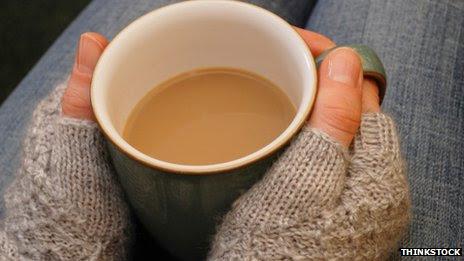 Hands holding mug