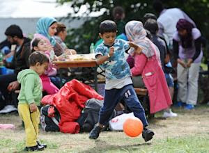 Migrant children play at a temporary camp for asylum-seekers …