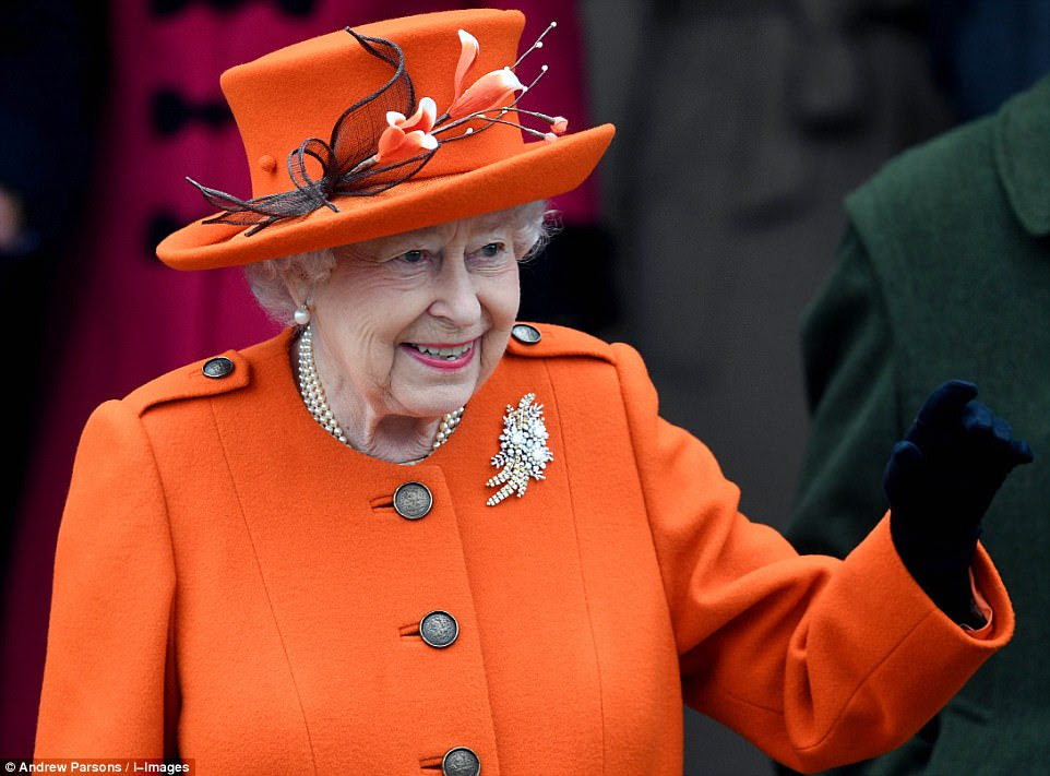 The Queen arrived at the service later by car wearing a bright orange jacket with an intricate floral hat