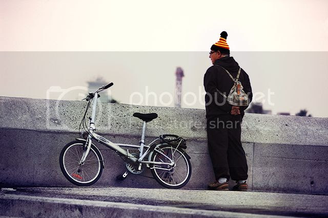 Man in Catalan Wool Knit Hat and Bike [enlarge]
