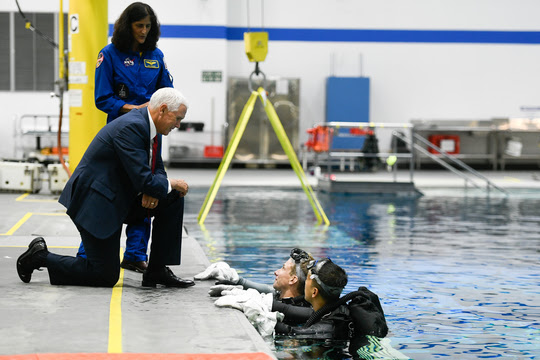Vice President Mike Pence speaks with astronauts training at the Neutral Buoyancy Lab (NBL)