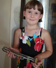 Maddison Johnson, 6, with a blown element from her family's hot water cylinder.