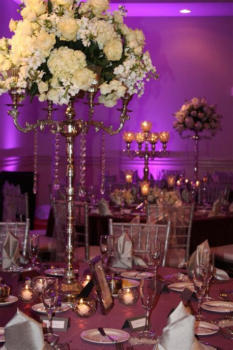 Purple and silver wedding reception centerpieces. Event