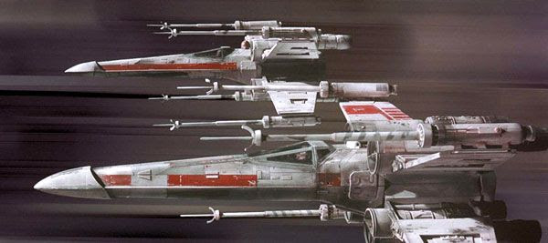 Two X-Wing starfighters soar through the Death Star's trench, 35mm film-style, in STAR WARS: EPISODE IV - A NEW HOPE.
