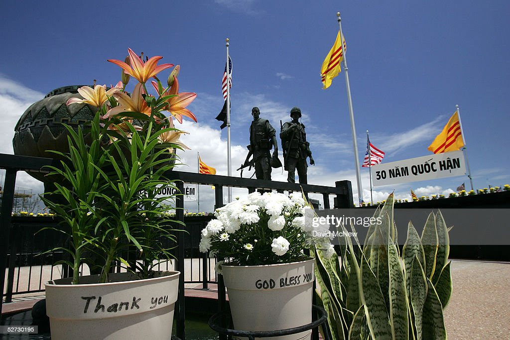 http://media.gettyimages.com/photos/flowers-with-messages-of-gratitude-are-left-at-the-vietnam-war-where-picture-id52730195