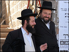 Ultra-orthodox Jews joke in Mea Shearim, Jerusalem