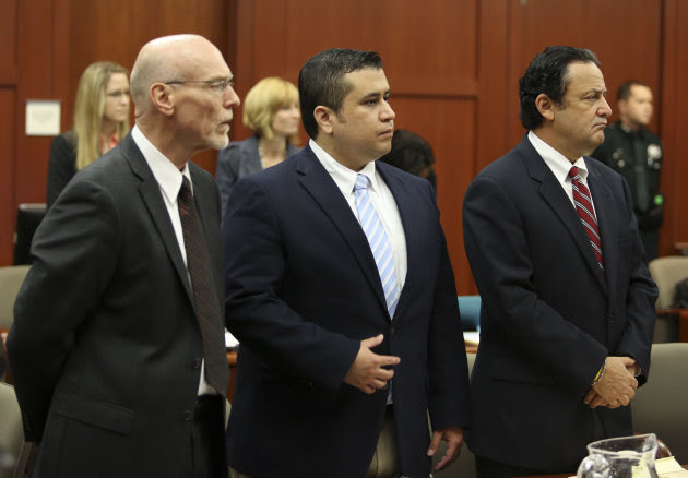 Attorney Don West, left, and jury consultant Robert Hirschhorn, right, stand with George Zimmerman as potential jurors enter the courtroom for Zimmerman's trial in Seminole circuit court in Sanford, Fla., Thursday, June 20, 2013. Zimmerman has been charged with second-degree murder for the 2012 shooting death of Trayvon Martin.(AP Photo/Orlando Sentinel, Gary Green, Pool)