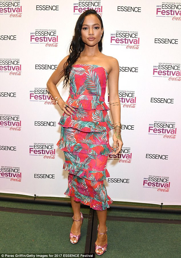 Pretty in pink: Karrueche Tran donned a palm-print, multi-peplum pencil dress for day three of the four-day Essence Festival in New Orleans on Saturday