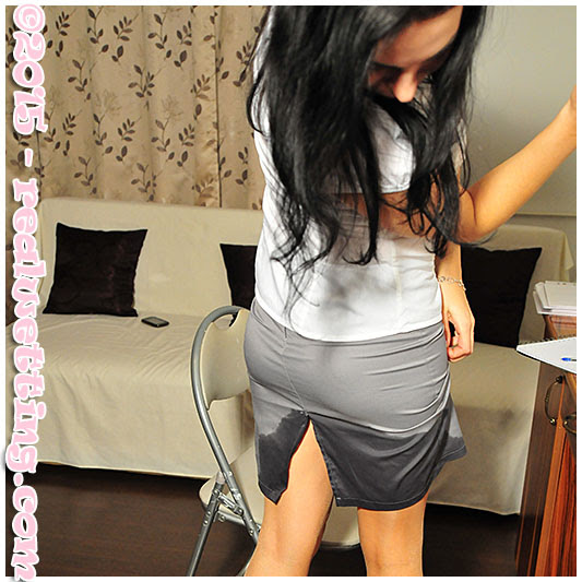 wetting herself at the office