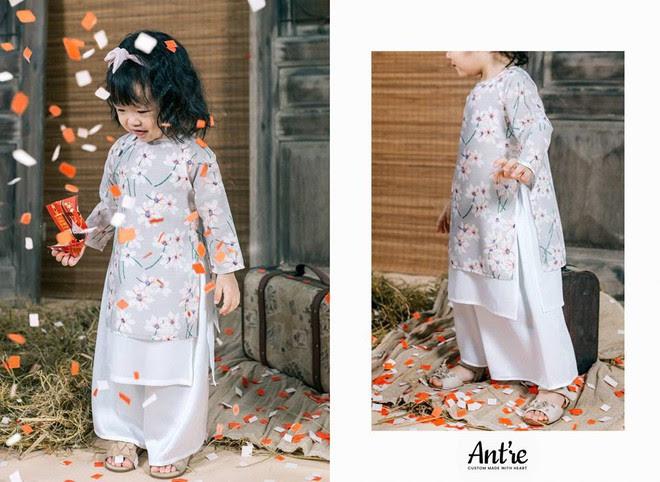 Không chỉ mỗi người lớn, nhiều hãng thiết kế Việt cũng giới thiệu tặng khá nhiều mẫu áo dài cách tân để các bé diện thật xinh xắn trong Tết này - Ảnh 1.