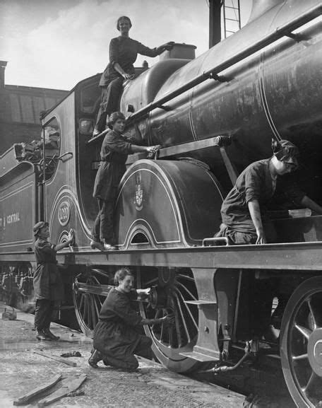 Female railway workers cleaning locomotives on the Great