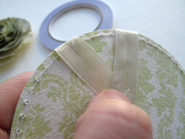 3 remove backing of doublesided tape, make a V with it & hold it with your thumb