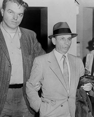 Meyer Lansky being led by detective for bookin...