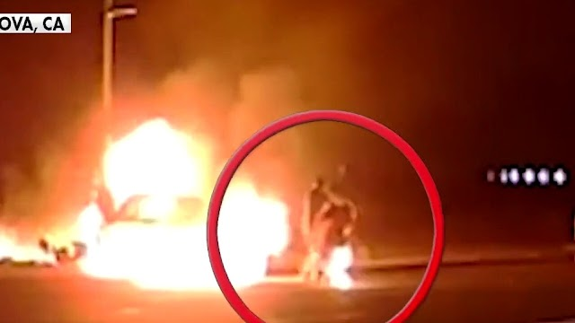 Off-duty officer saves two people from burning car
