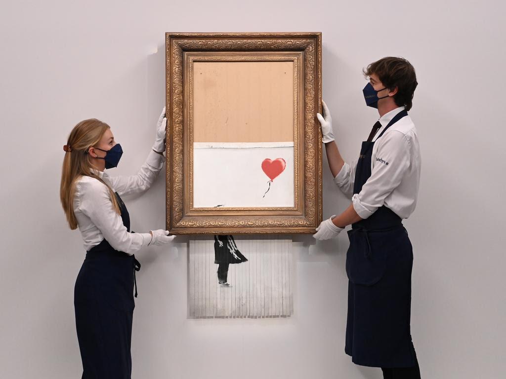 Versnipperd werk van Banksy levert 18,5 miljoen pond op bij veiling