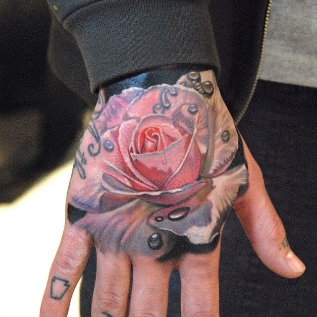 Rose Hand Tattoo By Phil Garcia Tattoomagz