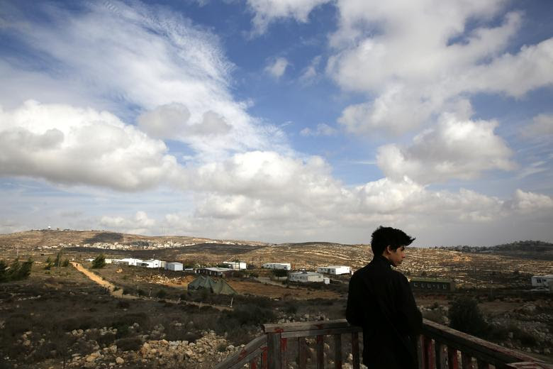 An Israeli youth stands on an observation point overlooking the Jewish settlers' outpost of Amona in the West Bank November 16, 2016. REUTERS/Ronen Zvulun