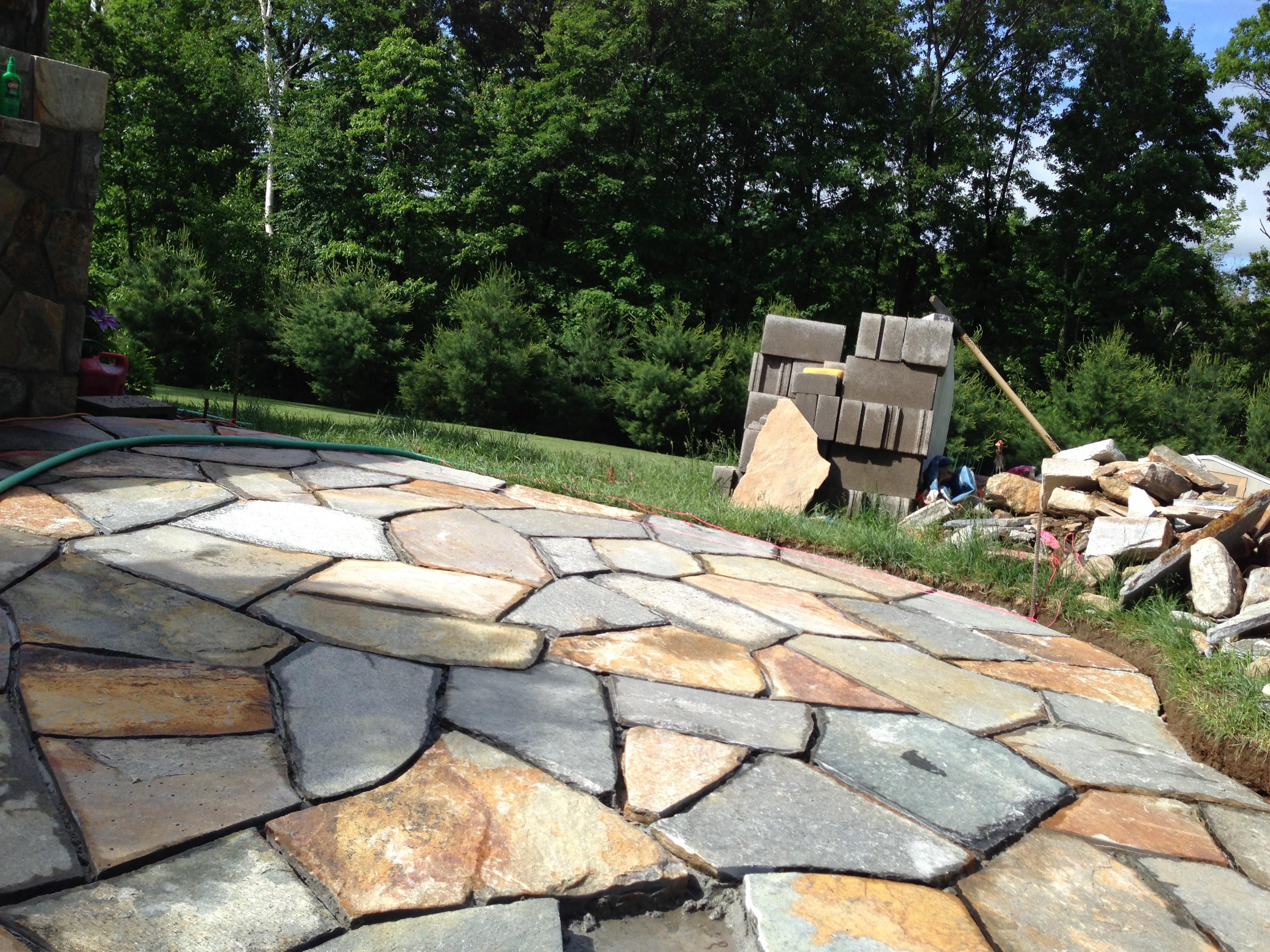 Outdoor Kitchen designer blends Bricks with stone to mesh the ...