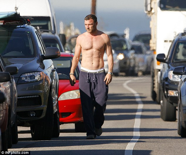 Fine form: Liev showed off his toned physique as he walked towards his car